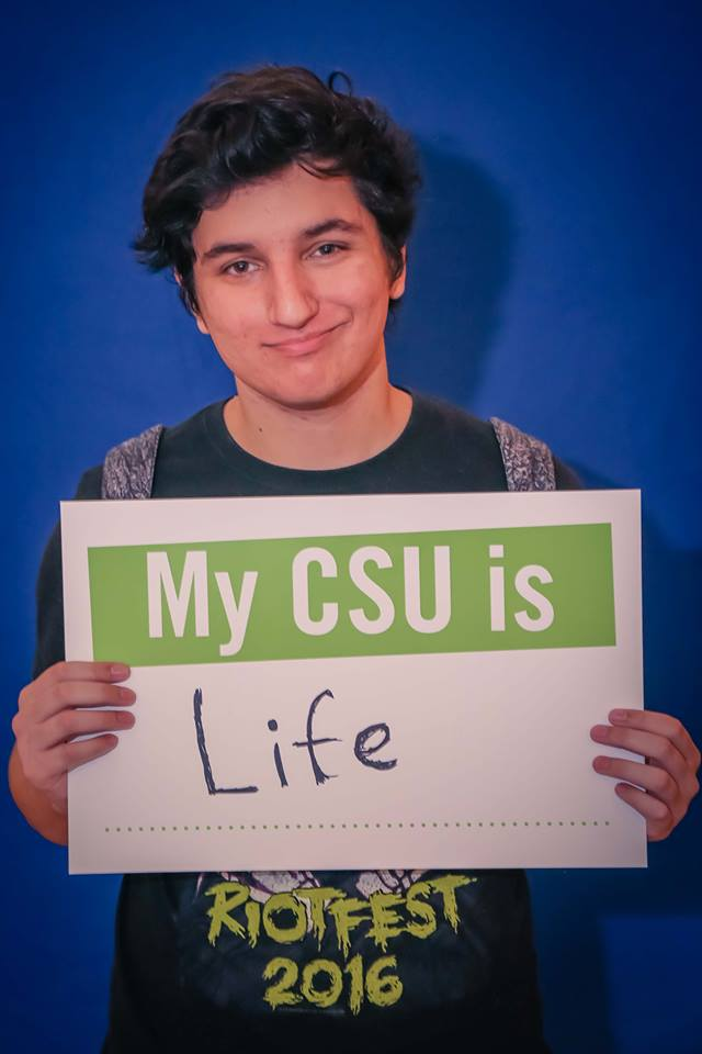 CSU Student with Sign Life