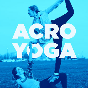 ladies doing acro yoga