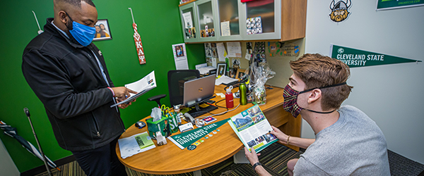 Cleveland State University admissions counselor speaking with new student