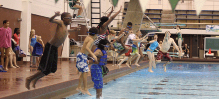 summer campers jump into pool