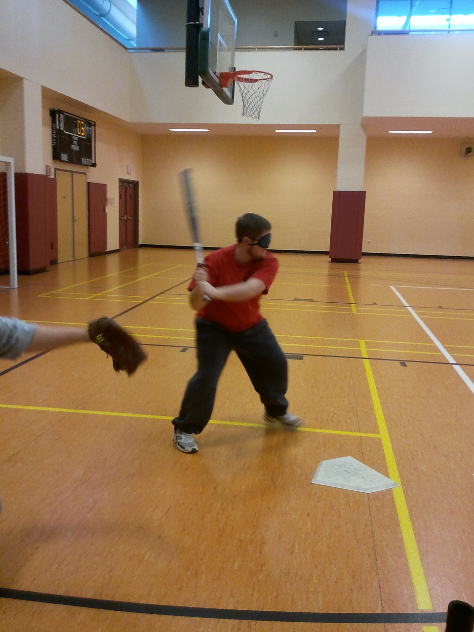 Blindfolded James in his batting Stance