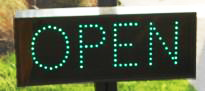 The Open sign indicating the garage is open.