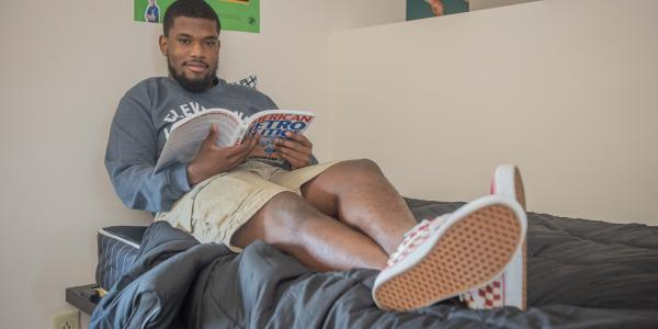Cleveland State student enjoys lounging in his residence hall.