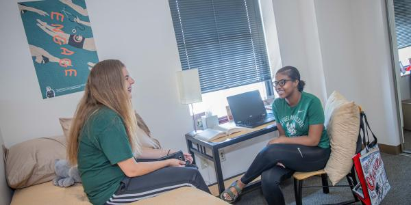 Two Cleveland State students just chatting in their residence hall.