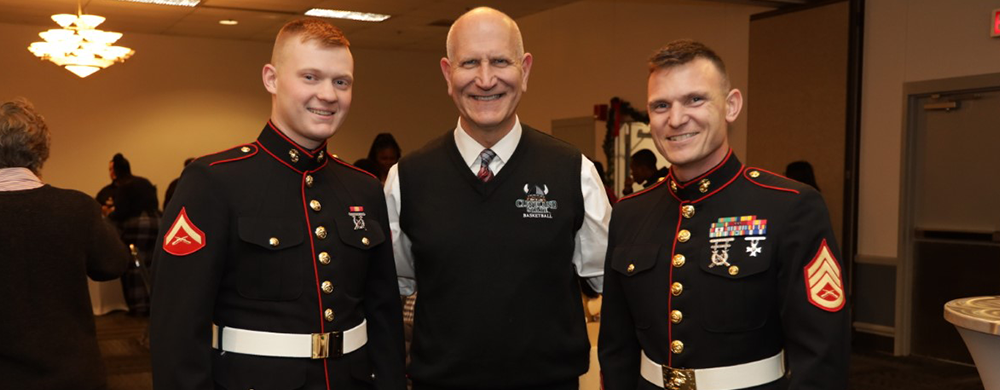 President Sands with marines at the President's Holiday Reception