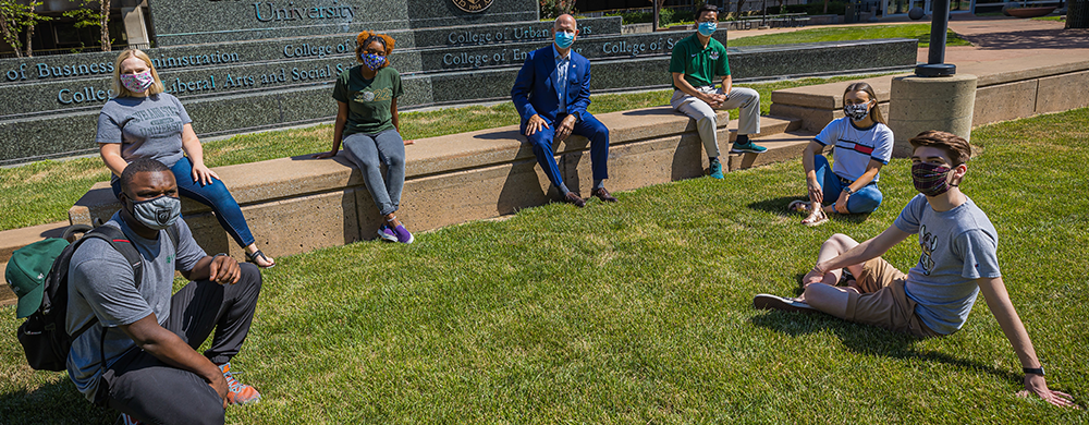 Cleveland State University President Sands and Provost Zhu with students outside wearing masks