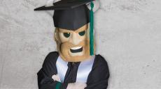 Magnus in graduation cap and gown